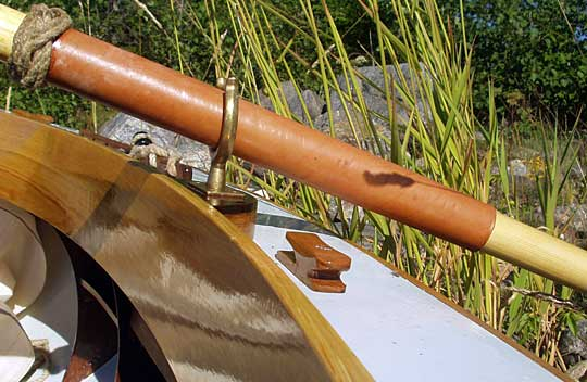 Oarlocks, leathered oars with a turks head knot